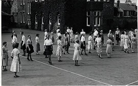 Photograph of a class dancing outside