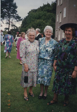 Photograph of a group taken at the 60th Summer School garden party