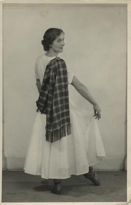 Photograph of Mina Corson demonstrating how to wear a sash