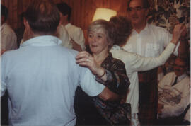 Photograph of Muriel Johnstone, dancing with an unnamed partner taken in the party room