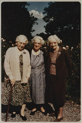 Photograph of Jean Milligan and her sisters Margaret (l) and Gertrude (r) in their garden at Biggar