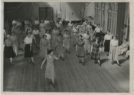 Photograph of Tihi West teaching the Ladies' Highland Class, in St Katherine's gym hall