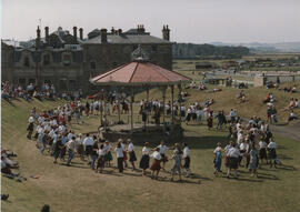 Photograph of dancers taking part in Dancing in the Streets 1994, dancing around the bandstand