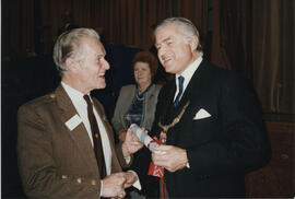 Photograph of Alastair Gillies receiving a Scroll from Lord Mansfield at the AGM in 1988.
