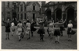 Photograph of people set dancing in the quad during Summer School