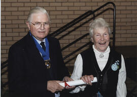 Photograph of Sally Dee receiving a scroll from Lord Mansfield at the AGM, 2004