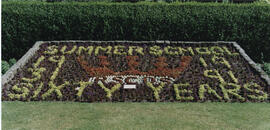 Photograph of a floral arrangement celebrating Sixty years of Summer School