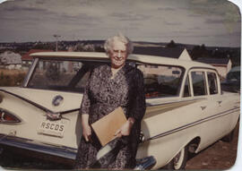 Photographs of Jean Milligan and others posing in front of cars with RSCDS number plates