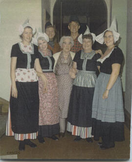 Photograph of group of people in Dutch national dress with Jean Milligan