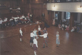 Photograph of the  'over sixties' team dancing in  the Younger Hall during the 60th Summer School