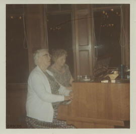 Photograph of Jean Milligan and Peg Rae in the 'old diner'
