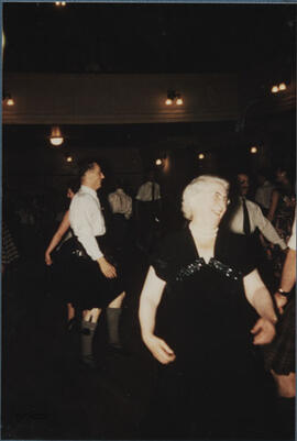 Photograph of Jean Milligan dancing the Axum Reel in the Younger Hall