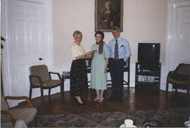 Photograph of Linda Gaul and Alan MacPherson being presented with Maggie MacDonald's notebook
