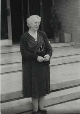 Photograph of Jean Milligan standing in front of Lumsden Hall