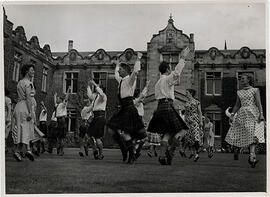 Photograph of set dancing, taken outside