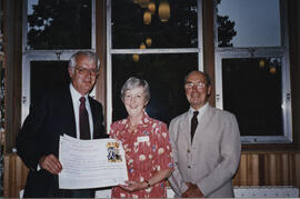 Photograph of a presentation to Jean Martin of Certificate of Congratulations on the RSCDS 80th anniversary and to commemorate its long association with St Andrews through Summer School
