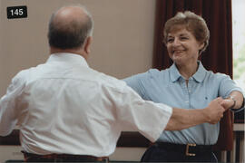 Photograph of Mary Murray and unnamed partner dancing in the Seniors class at Summer School