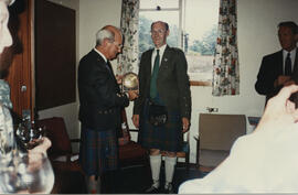 Photograph of a presentation to Dr Alastair MacFadyen by George Lawson