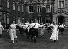 Photograph of a group set dancing, taken outside