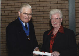 Photograph of Jennifer Wilson receiving a scroll from Lord Mansfield at the AGM, 2004