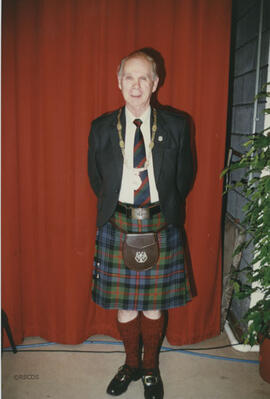 Photograph of Bill Clement wearing the Chairman's Chain of Office at the AGM 1996