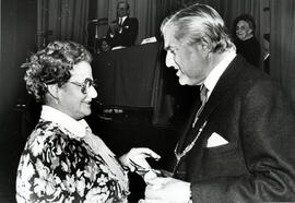 Photograph of Sheena MacLeod accepting Duncan MacLeod's scroll, awarded posthumously at the AGM, 1988