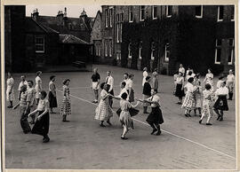 Photograph of a group dancing outside