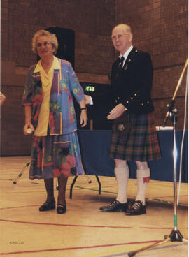 Photograph of Bessie Kemp (Teeside) receiving a scroll from Bill Clement