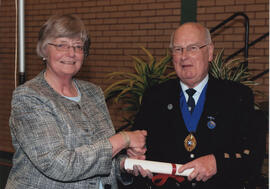 Photograph of Dorothy Hamilton being presented with a Scroll by Alastair MacFadyen at the AGM, 2009