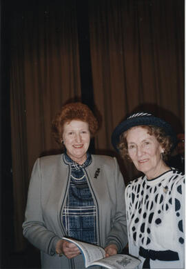 Photograph of Joan Moore and Muriel Gibson at the AGM in 1988.