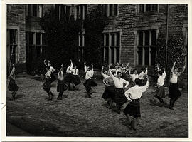 Photograph of participants dancing in the Men's Highland Class, at Summer School