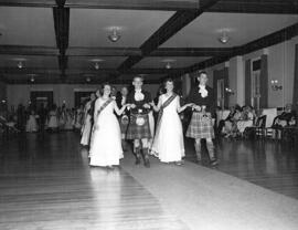 Photograph of the Grand March at the Crawford House Ball.  Led by Sandy Bostwick , David Givens, Barbara Ton, Nick Van Loan.