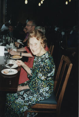 Photograph of Muriel Gibson at a formal dinner in University Hall