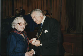 Photograph of Helene Jensen receiving a Scroll from Lord Mansfield at the AGM in 1988.