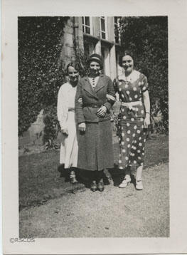 Photograph of three women taken outside