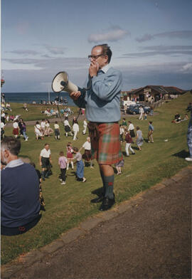 Photograph of Alastair Aitkenhead holding a megaphone directing participants during 'Dancing in t...