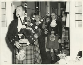 Photograph of Jean Milligan and others following a piper