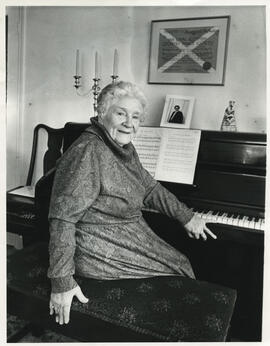 Photograph of Margaret (Peg) C. W. McAulay sitting at a piano