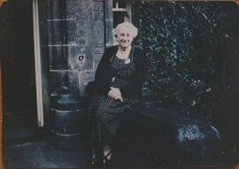 Photograph of Jean Milligan sitting outside University Hall