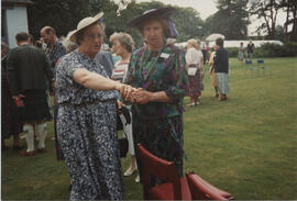 Photograph of Wilma Miller and Anna Holden taken at the 60th Summer School garden party