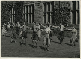 Photographs of Informal group dancing, taken outside at Summer School