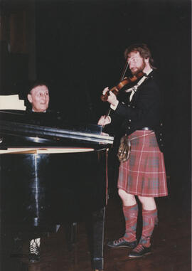 Photograph of Stan Hamilton and Alasdair Fraser Playing at a special dance party in memory of Tom Easton (San Francisco Branch)