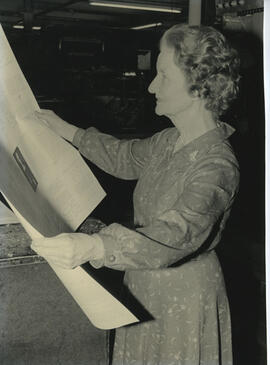Photograph of Muriel Gibson examining the proofs of Dance with your Soul