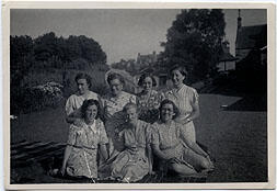 Photograph of a group of women sitting outside