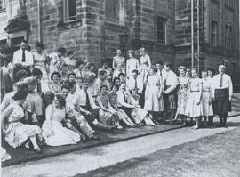 Photograph of a large group sitting outside