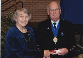 Photograph of Isabelle Macpherson  (Toronto Branch) being presented with a Scroll by Alastair MacFadyen at the AGM, 2009